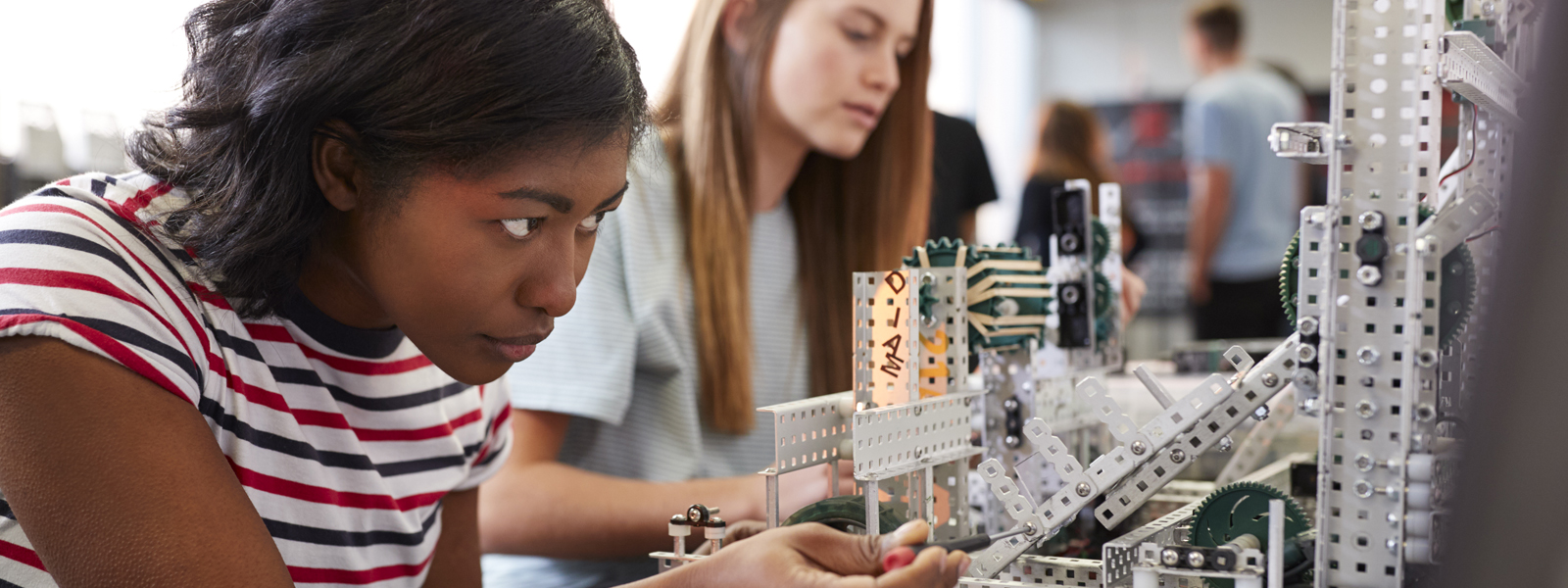 girl working closely with robotics