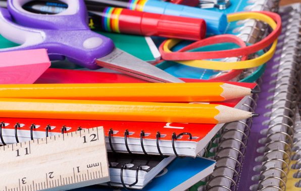 school supplies like notebooks, pencils, and rulers