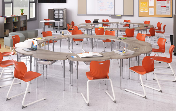 a classroom with desks arranged in circular groups