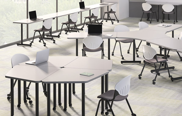 3D render of a well-lit classroom with larger, white tables and chairs